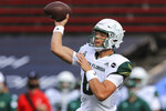 FILE - In this Oct. 3, 2020, file photo, South Florida quarterback Cade Fortin throws a pass during an NCAA college football game against Cincinnati in Cincinnati. Fortin started for North Carolina against rival North Carolina State in 2018 and will start against the Wolfpack again, this time for South Florida in Thursday's season opener. (AP Photo/Aaron Doster, File)