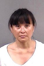 File - This undated file photo provided by the Berkeley Police Department shows Yvonne Felarca, of Oakland, Calif. Three protesters have entered no contest pleas Thursday, Nov. 14, 2019, to lesser charges stemming from a wild 2016 melee with white supremacists that injured at least 14 people at the California state Capitol. They include prominent San Francisco Bay Area anti-fascist leader Yvonne Felarca. She goes by Yvette Felarca while leading and speaking for the group known as BAMN, which stands for by any means necessary. (Berkeley Police Department via AP, File)