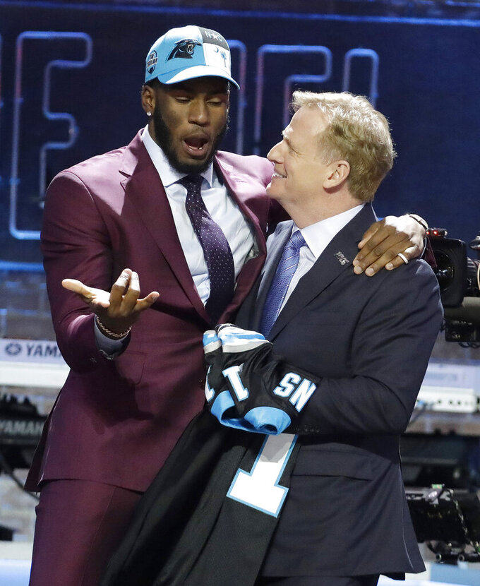 Florida State defensive end Brian Burns poses with NFL Commissioner Roger Goodell after the Carolina Panthers selected Burns in the first round at the NFL football draft, Thursday, April 25, 2019, in Nashville, Tenn. (AP Photo/Steve Helber)