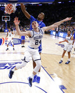 Seton Hall center Romaro Gilll, top, dunks over Villanova guard Joe Cremo (24) during the first half of an NCAA college basketball game in the championship of the Big East Conference tournament, Saturday, March 16, 2019, in New York. (AP Photo/Julio Cortez)