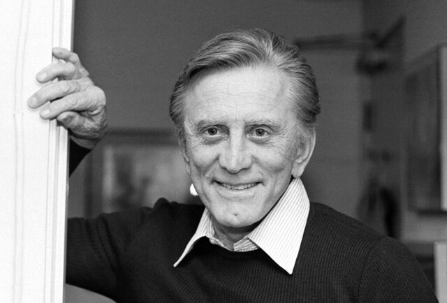 FILE - This Nov. 16, 1982 file photo shows actor Kirk Douglas at his home in Beverly Hills, Calif. Douglas died Wednesday, Feb. 5, 2020 at age 103. (AP Photo/Wally Fong, File)