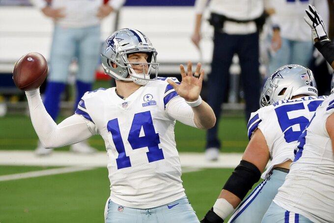 Dallas Cowboys quarterback Andy Dalton (14) throws a pass in the first half of an NFL football game against the Philadelphia Eagles in Arlington, Texas, Sunday, Dec. 27. 2020. (AP Photo/Michael Ainsworth)