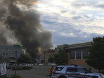 A major fire has broken out with a massive plume of smoke after a loud boom was heard in Sun Prairie, Wis., Tuesday, July 10, 2018. Firefighters from Sun Prairie and surrounding communities are responding to the blaze. (AP Photo/Todd Richmond)