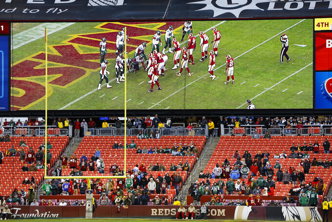 FILE - In this Nov. 17, 2019, file photo, some fans watch during the second half of an NFL football game between the Washington Redskins and the New York Jets, in Landover, Md. There were more than 20,000 empty seats for the Redskins' last home game, and when many of them have been filled this season, it's with fans of the visiting team. It could be even emptier Sunday when the 1-9 Redskins host the 3-6-1 Detroit Lions. (AP Photo/Patrick Semansky, File)
