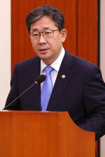 Park Yang-woo, minister of the Ministry of Culture, Sports and Tourism, speaks during a parliamentary committee meeting at the National Assembly in Seoul, South Korea, Monday, July 6, 2020. Top South Korean officials on Monday offered a public apology and vowed to delve into the death of a triathlete who had reported to government and sports bodies that she had been abused her team coach, physical therapist and colleagues. (Kim Sun-woong/Newsis via AP)