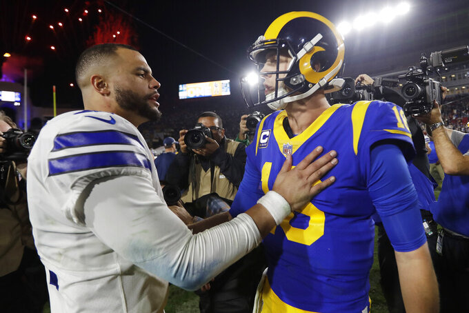 Los Angeles Rams quarterback Jared Goff, right, greets Dallas Cowboys quarterback Dak Prescott after their the Rams' win during an NFL divisional football playoff game Saturday, Jan. 12, 2019, in Los Angeles. (AP Photo/Jae C. Hong)