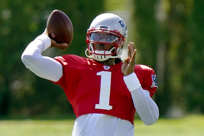 New England Patriots quarterback Cam Newton tosses the ball during an NFL football training camp practice, Tuesday, Aug. 18, 2020, in Foxborough, Mass. (AP Photo/Steven Senne, Pool)