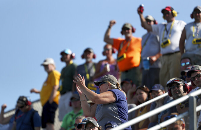 Fans watch the action during a NASCAR Cup Series auto race at Watkins Glen International, Sunday, Aug. 4, 2019, in Watkins Glen, N.Y. (AP Photo/John Munson)