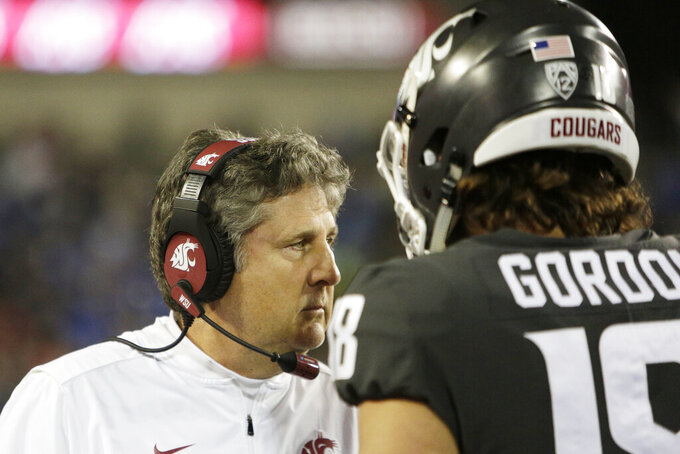 Washington State head coach Mike Leach, left, speaks with quarterback Anthony Gordon during the first half of an NCAA college football game against UCLA in Pullman, Wash., Saturday, Sept. 21, 2019. (AP Photo/Young Kwak)