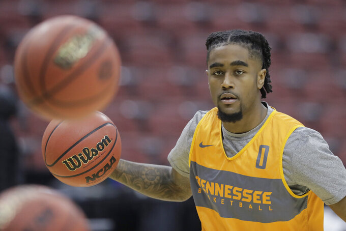 Tennessee's Jordan Bone dribbles during practice for the NCAA men's college basketball tournament, Wednesday, March 27, 2019, in Louisville, Ky. (AP Photo/Darron Cummings)