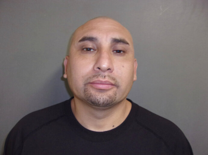 This booking photo provided by San Patricio County Sheriff's Office Ronnie Rodriguez Sr. Rodriguez Sr. was arrested Tuesday, Oct. 16, 2018, in connection with a shooting at a toddler's birthday party that left four men dead and a fifth wounded. The U.S. Marshals Service says Rodriguez Sr. was taken into custody at a motel in McAllen, Texas, near the U.S. border with Mexico. (San Patricio County Sheriff's Office via AP)