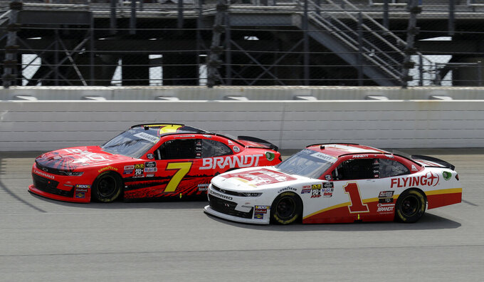 Justin Allgaier, left, and Michael Annett drive during a NASCAR Xfinity Series auto race at Chicagoland Speedway in Joliet, Ill., Saturday, June 29, 2018. (AP Photo/Nam Y. Huh)