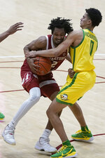 Stanford guard Bryce Wills, left, is defended by Oregon guard Will Richardson during the second half of an NCAA college basketball game in Stanford, Calif., Thursday, Feb. 25, 2021. (AP Photo/Jeff Chiu)