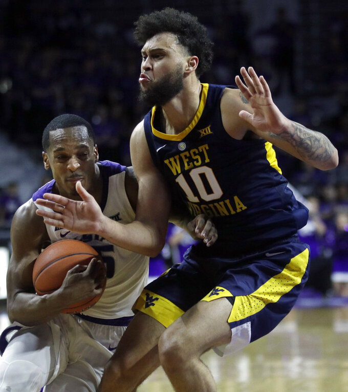 Kansas State guard Barry Brown Jr., left, drives the lane against West Virginia guard Jermaine Haley (10) during the second half of an NCAA college basketball game in Manhattan, Kan., Wednesday, Jan. 9, 2019. (AP Photo/Orlin Wagner)