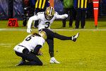 New Orleans Saints kicker Wil Lutz (3) kicks a field goal from the hold of Thomas Morstead in the second half of an NFL football game against the Chicago Bears in Chicago, Sunday, Nov. 1, 2020. (AP Photo/Charles Rex Arbogast)