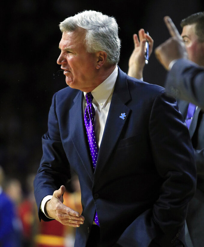 Kansas State head coach Bruce Weber yells to his team during the second half of an NCAA college basketball game against Iowa State in Manhattan, Kan., Saturday, Feb. 16, 2019. (AP Photo/Orlin Wagner)