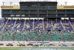 A limited amount of fans watch the start of a NASCAR Cup Series auto race at Kansas Speedway in Kansas City, Kan., Sunday, May 2, 2021. (AP Photo/Colin E. Braley)