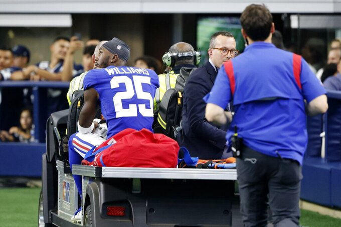 New York Giants cornerback Rodarius Williams (25) is carted off the field after suffering an unknown in injury in the second half of an NFL football game against the Dallas Cowboys in Arlington, Texas, Sunday, Oct. 10, 2021. (AP Photo/Michael Ainsworth)