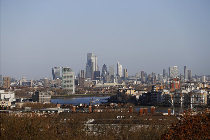 A general view over London from the Greenwich Observatory, with Tower Bridge and St Pauls Cathedral, left, and the City, of London, Saturday, March 27, 2021. Brexit and the coronavirus pandemic have hit London in a perfect storm. On May 6, Londoners will elect a mayor, whose performance will help determine whether this is the start of a period of decline for Europe's biggest city — or a chance to do things better. Current Mayor Sadiq Khan, who is favored to win re-election, says his top priority is preserving jobs threatened by the economic blow of the pandemic. Rival Shaun Bailey says his top priority is crime. Whoever wins will face the challenge of leading London's fightback from its biggest shock for generations. (AP Photo/Alastair Grant)