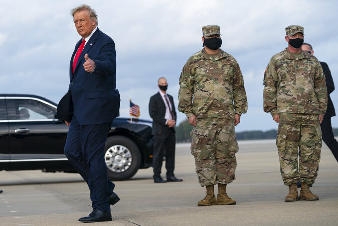 President Donald Trump gives a thumbs up after arriving at Pope Army Field for an event with troops at Fort Bragg, Thursday, Oct. 29, 2020, in Pope Field, N.C. (AP Photo/Evan Vucci)