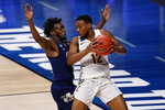 Loyola Chicago guard Marquise Kennedy, right, backs down Georgia Tech guard Bubba Parham in the first half of a college basketball game in the first round of the NCAA tournament at Hinkle Fieldhouse, Indianapolis, Friday, March 19, 2021. (AP Photo/AJ Mast)