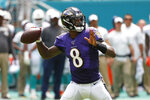 FILE - In this Sept. 8, 2019, file photo, Baltimore Ravens quarterback Lamar Jackson (8) looks to pass the ball during the first half at an NFL football game against the Miami Dolphins, in Miami Gardens, Fla. The Baltimore Ravens are really looking forward to seeing Terrell Suggs this Sunday _ right up until the opening kickoff of their game against the Arizona Cardinals. At the point, the Ravens will turn their attention toward keeping their former teammate clear of quarterback Lamar Jackson.(AP Photo/Wilfredo Lee, File)