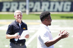 Iowa running back Ivory Kelly-Martin speaks during a news conference as coach Kirk Ferentz, left, looks on, Friday, June 12, 2020, in Iowa City, Iowa. The Iowa football team took a big step toward improving its lines of communication in the week since the program was hit with allegations of systemic racism, Ferentz and three of his players said Friday. (AP Photo/Charlie Neibergall)