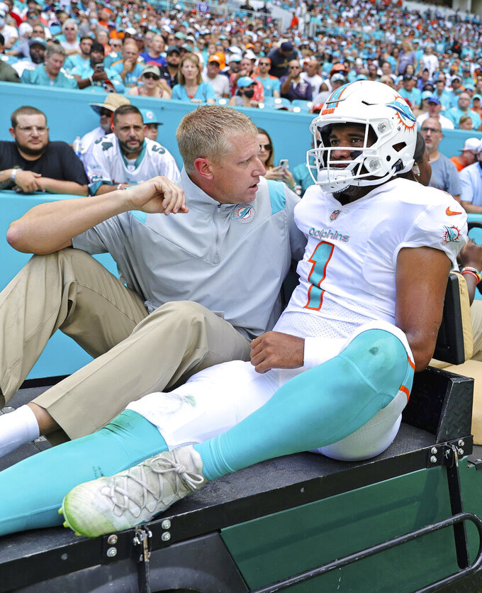 Miami Dolphins quarterback Tua Tagovailoa (1) carted out the field after getting injured in a play during the first quarter of an NFL football game against the Buffalo Bills at Hard Rock Stadium, Sunday, Sept. 19, 2021 in Miami Gardens, Fla.(David Santiago/Miami Herald via AP)
