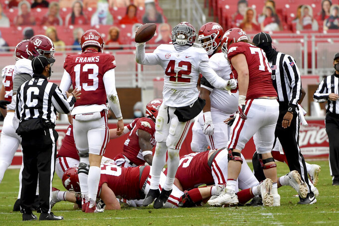 Alabama defender Jaylen Moody (42) celebrates after recovering an Arkansas fumble during the second half of an NCAA college football game Saturday, Dec. 12, 2020, in Fayetteville, Ark. (AP Photo/Michael Woods)