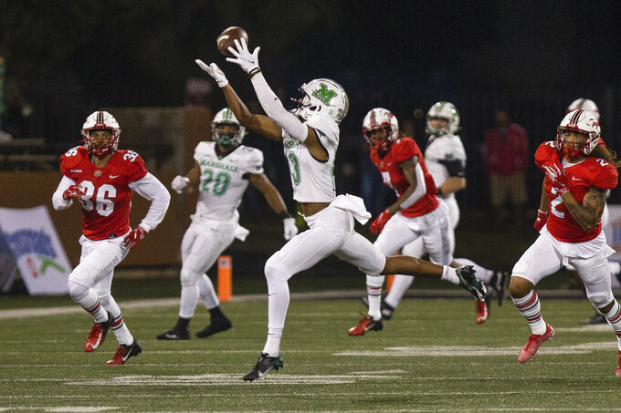 Marshall wide receiver Broc Thompson (13) makes a catch for a 30-yard gain against Western Kentucky during an NCAA college football game Saturday, Oct. 10, 2020, in Huntington, W.Va. (Sholten Singer/The Herald-Dispatch via AP)