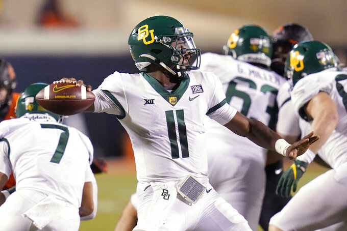 Baylor quarterback Gerry Bohanon (11) throws in the second half of an NCAA college football game against Oklahoma State, Saturday, Oct. 2, 2021, in Stillwater, Okla. (AP Photo/Sue Ogrocki)