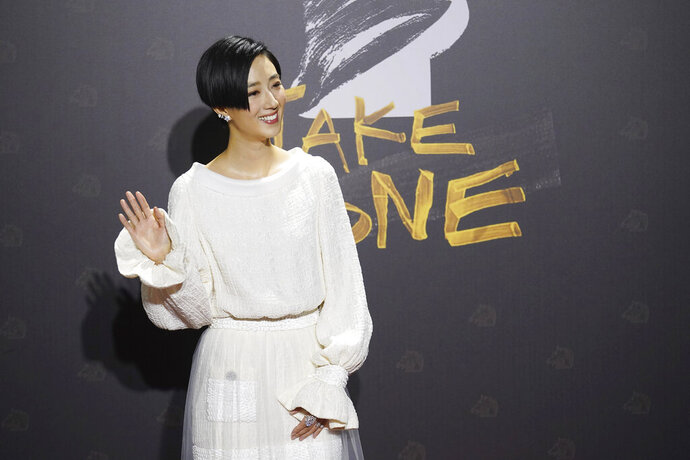 Taiwanese actress Gwei Lun-mei arrives at the 57th Golden Horse Awards in Taipei, Taiwan, Saturday, Nov. 21, 2020. Gwei is nominated for Best Leading Actress for the film