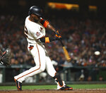 San Francisco Giants' Andrew McCutchen connects for an RBI single against the Cincinnati Reds during the fourth inning of a baseball game Tuesday, May 15, 2018, in San Francisco. (AP Photo/Ben Margot)