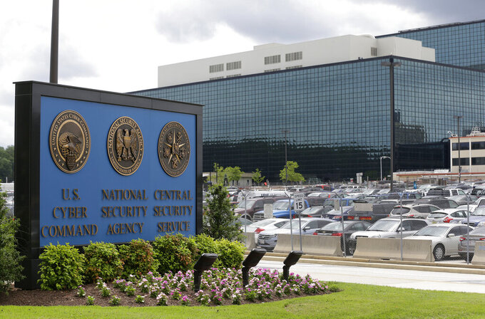 FILE - This Thursday, June 6, 2013 file photo shows the National Security Administration (NSA) campus in Fort Meade, Md. The number of targets of secretive surveillance in national security investigations fell sharply last year amid the coronavirus pandemic and continued scrutiny of the FBI's wiretapping authorities arising from the Russia investigation.  (AP Photo/Patrick Semansky, File)