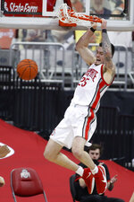 Ohio State's Kyle Young dunks against Northwestern during the second half of an NCAA college basketball game Wednesday, Jan. 13, 2021, in Columbus, Ohio. (AP Photo/Jay LaPrete)