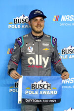 Alex Bowman hold the award flag in Victory Lane after winning the pole position during qualifying for the NASCAR Daytona 500 auto race at Daytona International Speedway, Wednesday, Feb. 10, 2021, in Daytona Beach, Fla. (AP Photo/John Raoux)