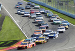 The field of drivers head into Turn 1 after a restart following a yellow caution flag during a NASCAR Cup Series auto race at Watkins Glen International, Sunday, Aug. 4, 2019, in Watkins Glen, N.Y. (AP Photo/John Munson)