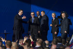 Turkey's President Recep Tayyip Erdogan, 2nd left, stands on a stage along with Aleksandar Vucic, left, the Serbian president, Milorad Dodik, 4th left, and Sefik Dzaferovic, 2nd right, both members of the Presidency of Bosnia and Herzegovina, and others, during a ceremony in Sremska Raca, some 80 Km west of Belgrade, Serbia, Tuesday, Oct. 8, 2019.  Erdogan attended a ceremony inaugurating a Turkey-financed highway linking Belgrade with Bosnia's capital of Sarajevo that is part of efforts to boost cooperation between former wartime foes. (AP Photo/Marko Drobnjakovic)