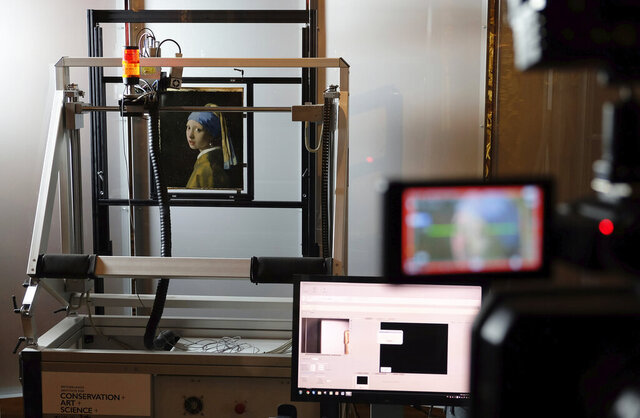 FILE - In this file photo dated Monday, Feb. 26, 2018, a macro XRF scanner is used to study in minute detail the surface of Johannes Vermeer's 17th century masterpiece