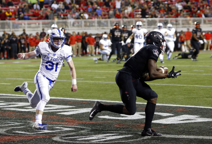 UNLV wide receiver Darren Woods Jr. (10) pulls in a touchdown pass ahead of Air Force defensive back Ross Connors (31) during the first half of an NCAA college football game in Las Vegas, Friday, Oct. 19, 2018. (Steve Marcus/Las Vegas Sun via AP)