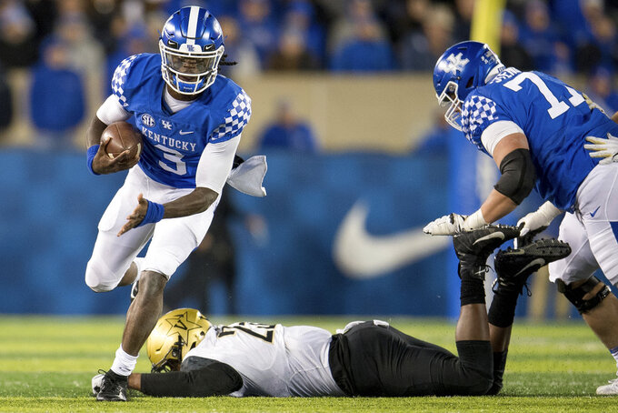 Kentucky quarterback Terry Wilson (3) runs with the ball during the second half of an NCAA college football game against Vanderbilt in Lexington, Ky., Saturday, Oct. 20, 2018. Kentucky won, 14-7. (AP Photo/Bryan Woolston)