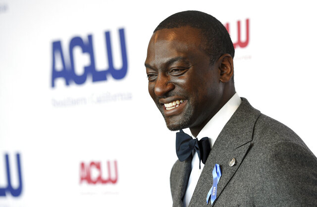 "FILE - Honoree Yusef Salaam poses at the ACLU SoCal's 25th Annual Luncheon in Los Angeles on June 7, 2019. Salaam, one of the five teens wrongly imprisoned for the assault of a Central Park jogger, has a memoir coming out in the spring. Grand Central Publishing announced Monday that it had acquired Yusef Salaam's ""Better, Not Bitter: Living On Purpose in The Pursuit of Racial Justice."" (Photo by Chris Pizzello/Invision/AP, File)"