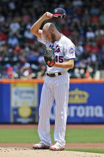 New York Mets starting pitcher Zack Wheeler pauses before throwing during the first inning of a baseball game against the Philadelphia Phillies at Citi Field, Sunday, July 7, 2019, in New York. (AP Photo/Seth Wenig)
