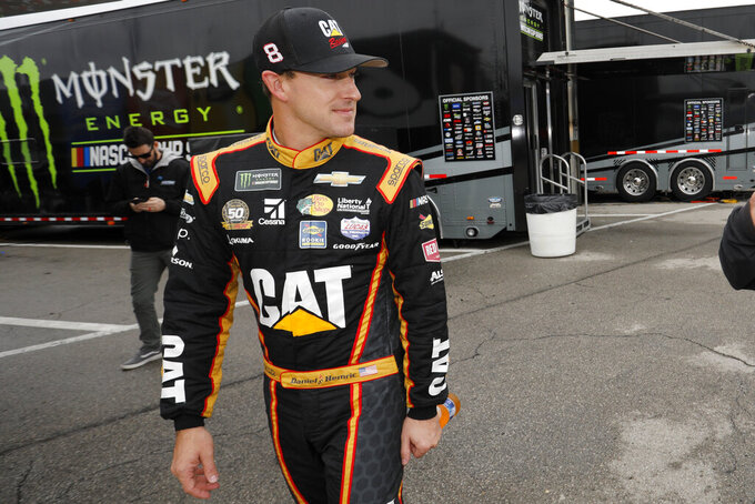 Daniel Hemric walks through the garage area after qualifying for a NASCAR Cup Series auto race at Kansas Speedway in Kansas City, Kan., Saturday, Oct. 19, 2019. (AP Photo/Colin E. Braley)