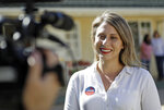 FILE - In this Nov. 6, 2018 file photo, Katie Hill, then a Democratic Party candidate from California's 25th Congressional district, talks to a reporter after voting in her hometown of Agua Dulce, Calif., a lightly populated expanse of grassy hills and horse ranchettes north of Los Angeles. She won the election, flipping a traditional GOP stronghold. Now, U.S. Rep. Katie Hill, D-Calif. has apologized to friends and supporters for engaging in an inappropriate affair with a campaign staffer, but she still let down Susan Slates, a fellow Democrat, who said she was