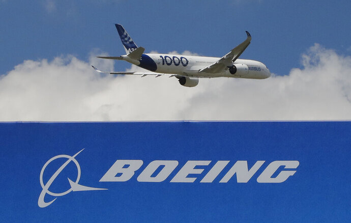 FILE - In this June 17, 2019, file photo, an Airbus A 350 - 1000 performs his demonstration flight at Paris Air Show in Le Bourget, east of Paris, France. Boeing's grounded 737 Max got a boost from two orders in November, but the American aircraft company continues to trail Europe's Airbus in both orders and deliveries of airline planes. Boeing disclosed Tuesday, Dec. 10, that it received 11 net orders in November, 63 new orders but 52 cancellations. (AP Photo/Michel Euler)