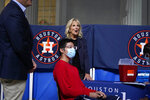 First lady Jill Biden and Doug Emhoff, left, attend a COVID-19 vaccination event at Minute Maid Park, in Houston, Tuesday, June 29, 2021. (AP Photo/Carolyn Kaster, Pool)