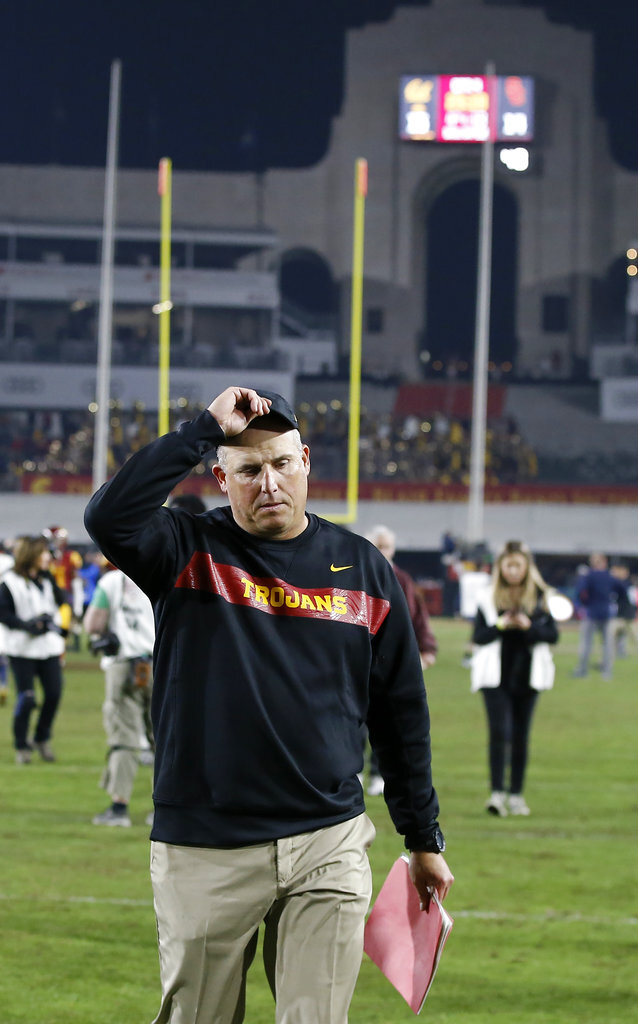 Southern California head coach Clay Helton walks off the field after a loss to California in an NCAA college football game in Los Angeles, Saturday, Nov. 10, 2018. California won 15-14. (AP Photo/Alex Gallardo)