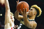 Colorado guard D'Shawn Schwartz (5) drives past Arizona forward Stone Gettings during the first half of an NCAA college basketball game Saturday, Jan. 18, 2020, in Tucson, Ariz. (AP Photo/Rick Scuteri)