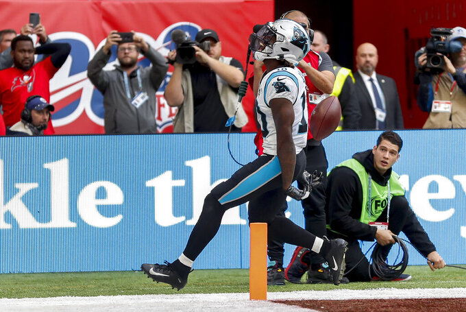 Carolina Panthers wide receiver Curtis Samuel (10) reacts as he scores a touchdown against the Tampa Bay Buccaneers during the third quarter of an NFL football game, Sunday, Oct. 13, 2019, at Tottenham Hotspur Stadium in London. (AP Photo/Alastair Grant)